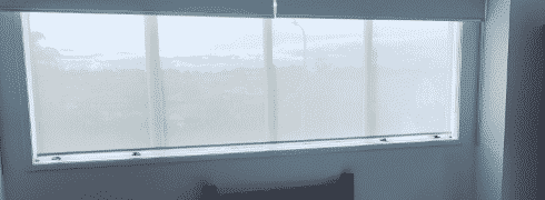 Room with dual roller blinds